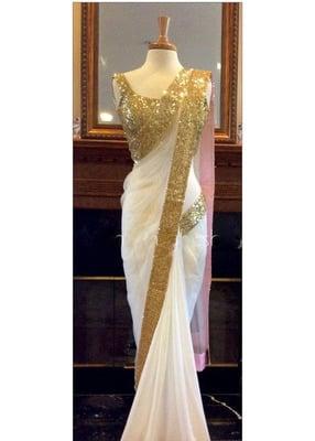 https://cdn0.desidime.com/attachments/photos/244172/medium/3452255glamour-tex-designer-white-embroidered-saree-product.jpg?1480949403