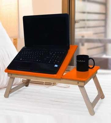 https://cdn0.desidime.com/attachments/photos/518993/medium/5028162portable-folding-laptop-cum-study-table-in-orange-colour-by-sattva-portable-folding-laptop-cum-study-cyyzzj.jpg?1528460666