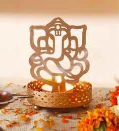 https://cdn0.desidime.com/attachments/photos/543900/medium/5504322golden-finish-metal-lord-ganesha-tealight-holder-by-anasa-golden-finish-metal-lord-ganesha-tealight--0qxowo.jpg?1545889792