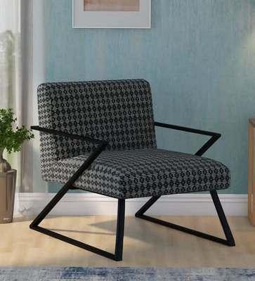 https://cdn0.desidime.com/attachments/photos/595867/medium/6282774grace-upholstered-armchair-with-base-in-grey-finish-by-bohemiana-grace-upholstered-armchair-with-bas-ovepxo.jpg?1574423345