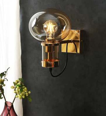 https://cdn0.desidime.com/attachments/photos/601913/medium/6434302janssen-gold-metal-and-glass-wall-light-by-casacraft-janssen-gold-metal-and-glass-wall-light-by-casa-zbqwdv.jpg?1578742892